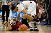 Stanford Landry Fields goes down under Jerren Shipp. The Stanford Cardinal, ranked 7th in the Pac-10 defeated the 2nd ranked Arizona State Sun Devils 70-61 during the Pac-10 Tournament at the Staples Center in Los Angeles, California on March 11th, 2010.