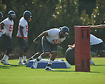 Ole Miss' Justin Smith (93) goes through a drill at  football practice in Oxford, Miss. on Sunday, August 7, 2011.