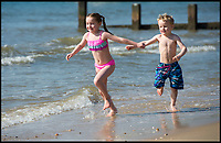 BNPS.co.uk (01202 558833)<br /> Pic: PhilYeomans/BNPS<br /> <br /> Emma(7) and Jack(5) Curry.<br /> <br /> Holidaymakers make the most of the first hot weekend of the year on Bmthn beach today.