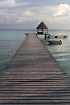 Rangiroa Atoll, Tuamotu Archipelago, French Polynesia; view of the boat dock and pier at the Hotel Kia Ora Resort and Spa in late afternoon sunlight