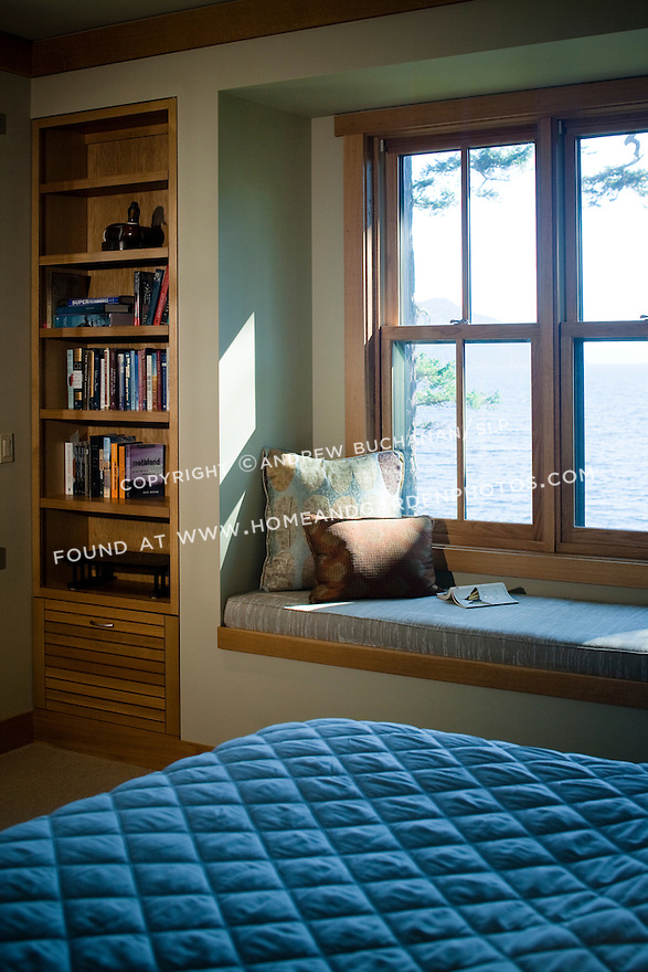 A bedroom window seat offers a quiet place to read in this waterfront home. this image is available through an alternate architectural stock image agency, Collinstock located here: http://www.collinstock.com