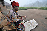 A woman prepares cassava for cooking in the Congolese village of Wembo Nyama.