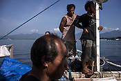 Fishermen wait for a smaller boat to appear to offload the sustainably caught tuna to sell to a buying unit in Puerto Princesa, Palawan in the Philippines. <br /> Photo: Sanjit Das/Panos for Greenpeace