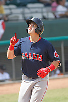 Salem Red Sox center fielder Tate Matheny (19) touching home plate after hitting a home run during a game against the Down East Wood Ducks  at Grainger Stadium on April 16, 2017 in Kinston, North Carolina. Salem defeated Down East 9-2. (Robert Gurganus/Four Seam Images)