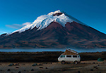 Snowcapped Cotopaxi Volcano seen from the high plains of Cotopaxi National Park in Ecuador. Cotopaxi is a stratovolcano and one of the highest active volcanoes in the world.  The park is popular with campers.