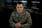 13th Intelligence Squadron commander Lt. Colonel Jason Brown poses for a portrait on the operations floor at Beale Air Force Base in Linda, Calif., April 30, 2010.