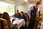 Rocky Mountaineer is a Canadian tour company that operates trains on four rail routes through British Columbia and Alberta.  Pictured here is the route from Kamloops, British Columbia to Banff, Alberta, Canada. Gold Leaf service offers a domed car with outstanding views of the surrounding terrain. The dining room in Gold Leaf