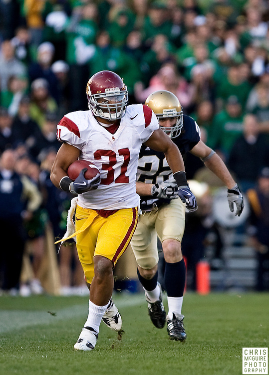 10/17/09 - South Bend, IN:  USC FB Stanley Havili gets a big gain against Notre Dame during their game at Notre Dame Stadium on Saturday.  USC won the game 34-27 to extend its win streak over Notre Dame to 8 games.  Photo by Christopher McGuire.