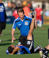 Earthquakes' head athletic Trainer Bruce Morgan works with Ramiro Corrales during practice before the game against the Red Bulls at Buck Shaw Stadium in Santa Clara, California.  San Jose Earthquakes defeated New York Red Bulls, 4-0.