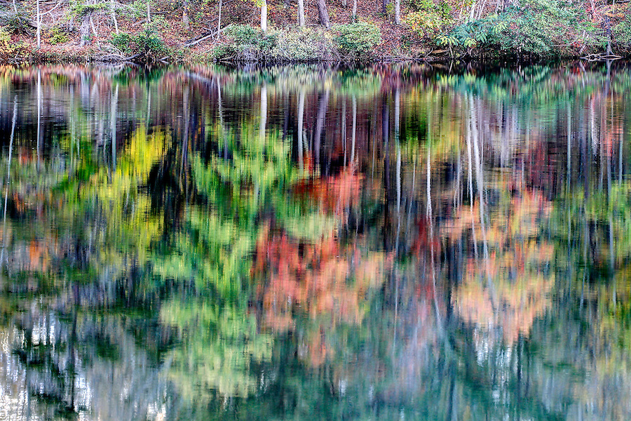Fall colored trees are reflected in the waters of the reservoir at Beaver Creek Dam in Crozet, Va. Photo/Andrew Shurtleff