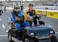 Jul 29, 2016; Sonoma, CA, USA; NHRA funny car driver Ron Capps with an NHRA official during qualifying for the Sonoma Nationals at Sonoma Raceway. Mandatory Credit: Mark J. Rebilas-USA TODAY Sports