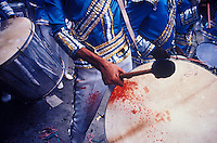 Rio de Janeiro Carnival, Samba Schools Parade in Sambodromo, Brazil. Dedication, drummer bleeds during long performance and does not stop playing.