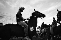 Suicide Racers on horseback prepare to enter the Omak Stampede arena before the start of the race. The Omak Suicide Race is part of the Omak Stampede, a rodeo which is held on the Colville Native American / Indian Reservation...