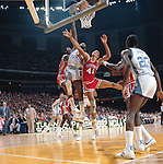 27 MAR 1982:  North Carolina forward James Worthy (52), guard Michael Jordan (23) and Houston center Akeem Abdul Olajuwon (35) and center Larry Micheaux (41) during the NCAA Men's National Basketball Final Four semifinal game held in New Orleans, LA, at the Superdome. North Carolina defeated Houston 68-63 to meet Georgetown in the championship game. Worthy was named MVP for the tournament. Rich Clarkson/NCAA Photos.SI CD 0023-04