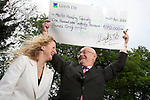 Lloyds Bank present Merlin Housing Society with charity cheque.