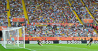 Carli Lloyd (r) of team USA scores at the penalty shootout against Andreia of team Brazil during the FIFA Women's World Cup at the FIFA Stadium in Dresden, Germany on July 10th, 2011.