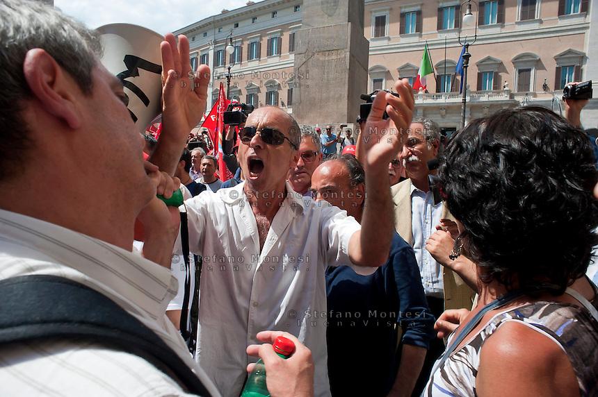 Roma 27 Giugno 2012.Manifestazione  dei sindacati di base  contro la riforma del lavoro e il ministro Fornero..Un manifestante della CGIL contesta i  sindacati di base  in piazza Montecitorio dal servizio