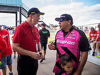 Oct 16, 2016; Ennis, TX, USA; NHRA funny car driver Cruz Pedregon (right) talks to NHRA president Peter Clifford during the Fall Nationals at Texas Motorplex. Mandatory Credit: Mark J. Rebilas-USA TODAY Sports