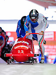 18 December 2010: Simone Bertazzo starts up his 2-man bobsled for Italy, taking the gold at the Viessmann FIBT World Cup Bobsled Championships on Mount Van Hoevenberg in Lake Placid, New York, USA. Mandatory Credit: Ed Wolfstein Photo