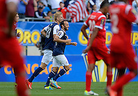 Chicago, IL - Sunday July 28, 2013:   USMNT forward Landon Donovan (10) celebrates with teammates after a goal is scored during the CONCACAF Gold Cup Finals soccer match between the USMNT and Panama, at Soldier Field in Chicago, IL.