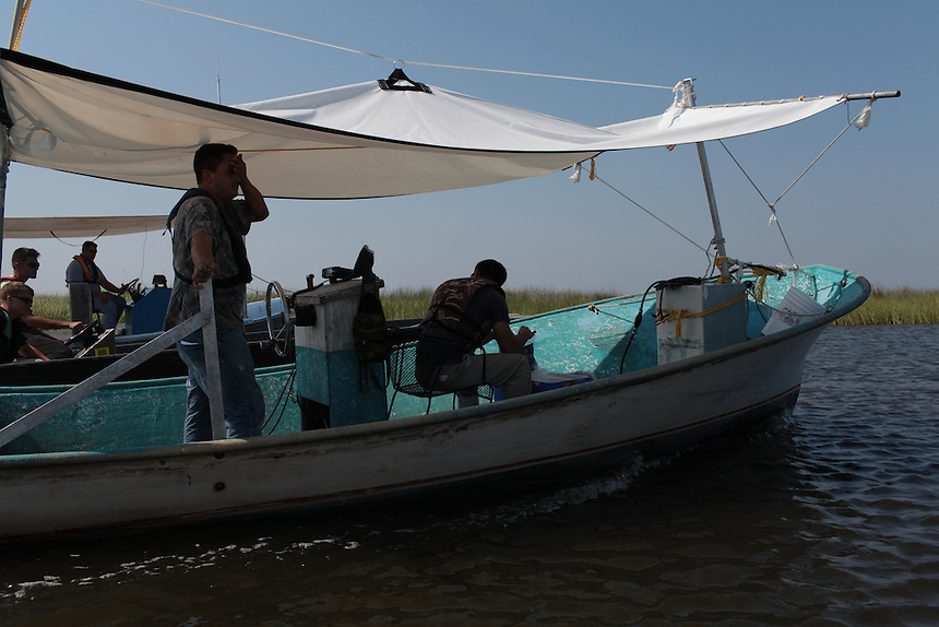 Local fishermen take a break from collecting oil contaminated boom on August 24th.