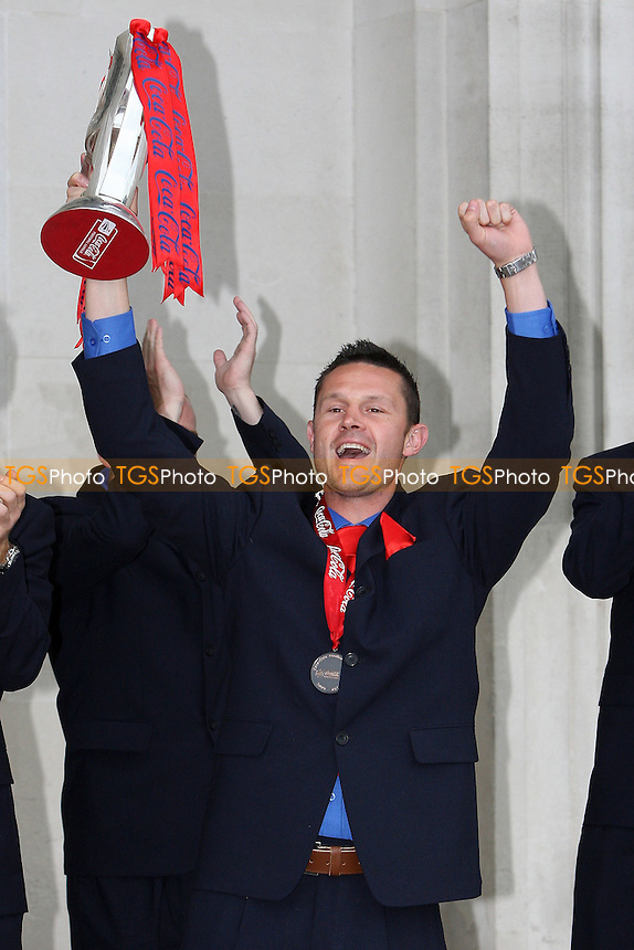 Dagenham skipper Mark Arber shows the Trophy to the fans - League Two Play-Off winners Dagenham & Redbridge FC attend a reception at Dagenham Civic Centre and then journey back to Victoria Road by open top bus - 31/05/10 - MANDATORY CREDIT: Gavin Ellis/TGSPHOTO - Self billing applies where appropriate - Tel: 0845 094 6026