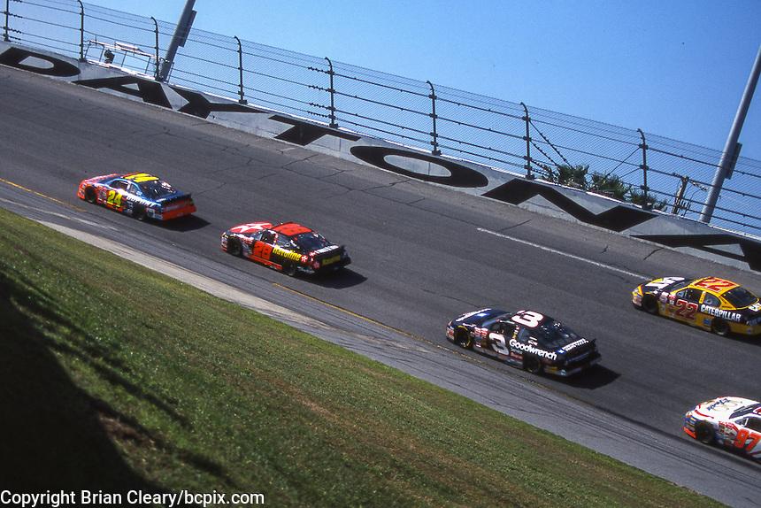 Jeff Gordon (24) Ricky Rudd (28) Dale Earnhardt (3) Ward Burton (22) Kurt Busch (97) action, Daytona 500, Daytona International Speedway, Daytona Beach, FL, February 18, 2001.  (Photo by Brian Cleary/ www.bcpix.com )
