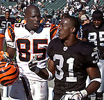 Cincinnati Bengals wide receiver Chad Ochocinco  (85) and Oakland Raiders defensive back Phillip Buchanon (31) talk after game on Sunday, September 14, 2003, in Oakland, California. The Raiders defeated the Bengals 23-20.