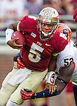 Quarterback Jameis Winston (5) shakes a tackle from Syracuse lineman Eric Crume during a scramble as the FSU Seminoles defeat the Syracuse Orange 59-3 at Doak S Campbell Stadium in Tallahassee, Florida November 16, 2013.