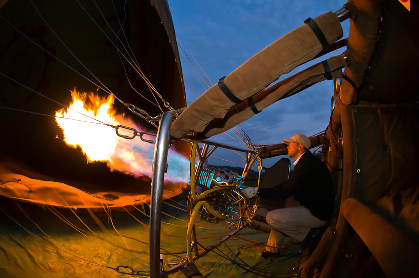 Balloon pilot J. P. Lemaire of Transworld Safaris inflates a balloon for a sunrise flight over Masai Mara National Reserve, Kenya