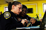 New Jersey, United States. 15th February 2013 -- NJ police officers check a weapon after being acquired during the Gun Buyback program in New Jersey. Photo by Eduardo Munoz Alvarez / VIEWpress.