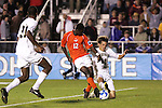 14 December 2007: Wake Forest's Evan Brown (18) tries to stop a shot by Virginia Tech's Patrick Nyarko (GHA) (12). The Wake Forest University Demon Deacons defeated the Virginia Tech University Hokies 2-0 at SAS Stadium in Cary, North Carolina in a NCAA Division I Men's College Cup semifinal game.