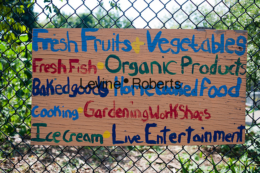 Farmers' Market sign outside of East New York Farms in Brooklyn in New York on Saturday, September 1, 2012. The farm, which had its first season in 1998, promotes local sustainable agriculture with volunteer opportunities,  a Community Supported Agriculture (CSA) program, a farmers' market and a nine month internship program. (© Richard B. Levine).