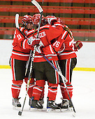 Bailey Habscheid (St. Lawrence - 21), Josee Belanger (St. Lawrence - 4), Kelly Sabatine (St. Lawrence - 16) - The Harvard University Crimson defeated the St. Lawrence University Saints 8-3 (EN) to win their ECAC Quarterfinals on Saturday, February 26, 2011, at Bright Hockey Center in Cambridge, Massachusetts.