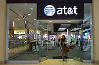 New York, United States. 19th May 2014 - A customer exits one AT&T store in Jersey City, New Jersey. Photo by Eduardo MunozAlvarez/VIEW