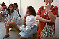 Somália sits outside a Rio de Janeiro clinic with a line of other women awaiting pregnancy test results. After 15 years of nearly constant pregnancy and with six mouths to feed, the possibility of another pregnancy caused a great deal of anxiety. Somália had tried birth control pills this time, but improper use rendered them ineffective.