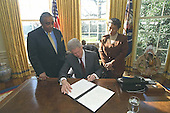 United States President Bill Clinton signs the executive order for the President's council on the future of Princeville, North Carolina in the Oval Office of the White House in Washington, D.C. on February 29, 2000 as U.S. Representative Charles Rangel (Democrat of New York), left, and U.S. Representative Eva Clayton (Democrat of North Carolina), right, witness.   .Mandatory Credit: David Scull / White House via CNP
