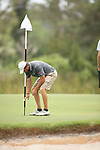 HOWEY IN THE HILLS, FL - MAY 19: Ty Palmer of Guilford College picks his ball up from the hole after hitting a 54 degree wedge shot from 102 yards during the Division III Men's Golf Championship held at the Mission Inn Resort and Club on May 19, 2017 in Howey In The Hills, Florida. (Photo by Cy Cyr/NCAA Photos via Getty Images)