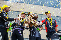 Jul 10, 2016; Joliet, IL, USA; (From left) NHRA top fuel driver Antron Brown , funny car driver Jack Beckman , pro stock driver Greg Anderson and pro stock motorcycle rider Andrew Hines celebrate after winning the Route 66 Nationals at Route 66 Raceway. Mandatory Credit: Mark J. Rebilas-USA TODAY Sports