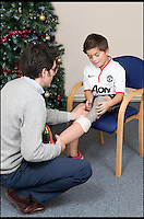 BNPS.co.uk (01202 558833)<br /> Pic: RachelAdams/BNPS<br /> <br /> Prosthetist Matthew Hughes fits Leon's new leg. <br /> <br /> Perfect gift for Xmas...