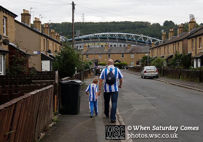 Huddersfield Town 1 Wolverhampton Wanderers 0, 27/08/2016. John Smith's Stadium, Championship. Huddersfield fans walking down Town Terrace. Photo by Paul Thompson.