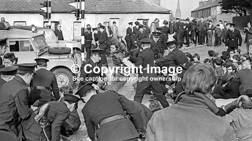 RUC clash with People's Democracy marchers in Lurgan, Craigavon, N Ireland, 4th April 1969. PD members, taking part in an Easter weekend Belfast-Dublin march, were attempting to march through the town centre and police wanted to divert them away from loyalists in another part of the town. 196904040148<br />