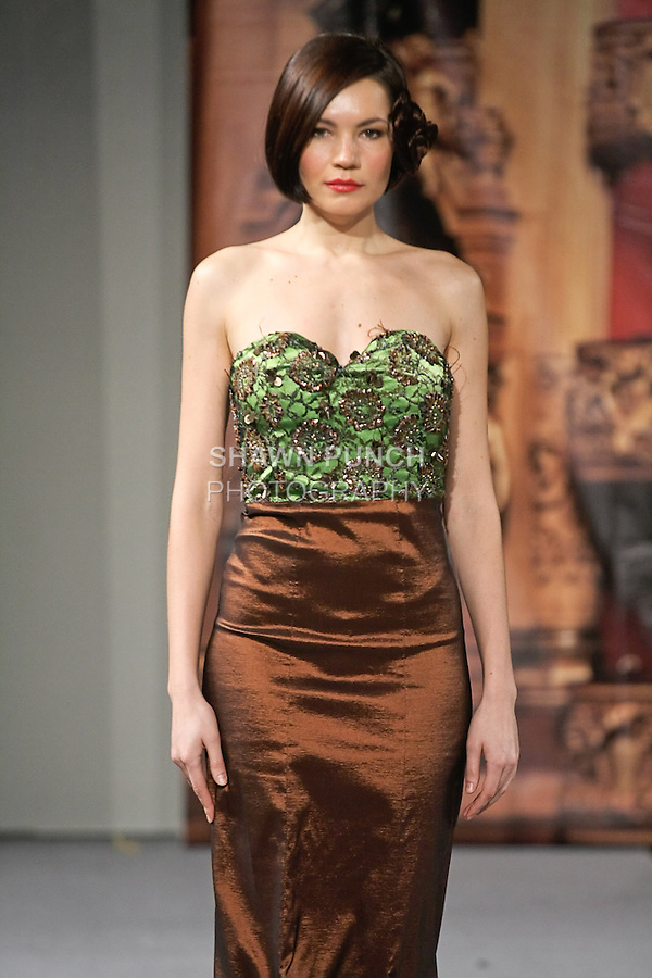 Model walks runway in an outfit from Andres Aquino Fall 2012 collection, during Couture Fashion Week New York, February 18, 2012.