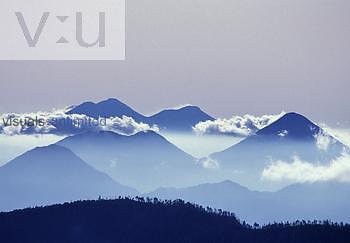 Multiple major volcanos viewed from the summit of Santa Maria Volcano, Guatemala.