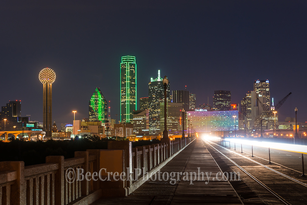 This is a image of Dallas skyline from the freeway.  We like the way the hwy led you eye straight down to the city with all the usual high rise skycrapers like the Bank of America, Fountain Place, Reuion Tower, Heritage Plaza, Omin Hotel nad many ohters.