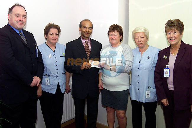 Helena Kirwan presenting a cheque to Dr. Santhosh David for the Cardiac Unit in the Lourdes Hospital. Also pictured are Declan Collins, acting General Manager, Nuala Sharkey, Pauline Plunkett and Mary Quirk, nursing administration..Picture: Paul Mohan/Newsfile