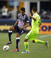 Sergio Santana, left, of CF Monterrey changes direction on David Estrada of the Seattle Sounders FC during a CONCACAF Champions League match at CenturyLink Field in Seattle Tuesday Oct. 18, 2011. CF Monterrey won the game 2-1.