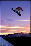 trevor andrew soars above the halfpipe in mammoth, california, usa.