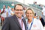 20 August 2014: Play by play broadcaster Dean Linke (left) with Switzerland head coach Martina Voss-Tecklenburg (GER) (right). The United States Women's National Team played the Switzerland Women's National Team at WakeMed Stadium in Cary, North Carolina in an women's international friendly soccer game. The United States won the match 4-1.