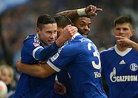 FUSSBALL   1. BUNDESLIGA   SAISON 2012/2013    25. SPIELTAG FC Schalke 04 - Borussia Dortmund                         09.03.2013 Julian Draxler (li) bejubelt mit Sead Kolasinac und Michel Bastos  (v.l., alle FC Schalke 04) sein Tor zum 1:0